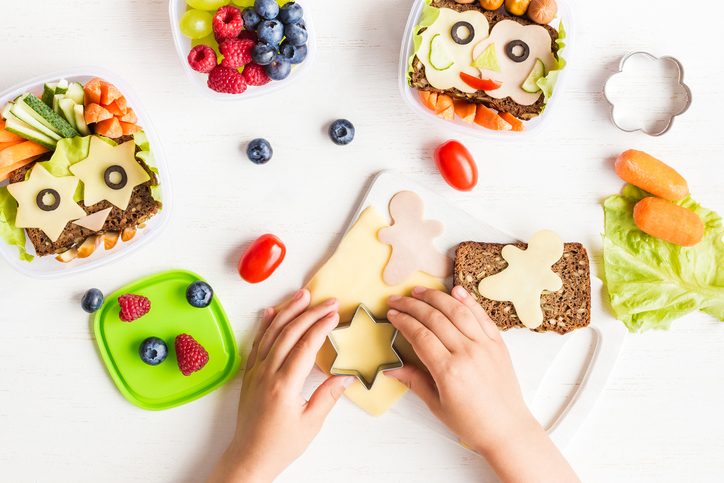 School lunch box for kids. Cooking. Child's hands. Top view