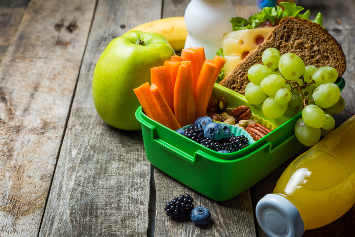 Healthy school lunch box on rustic background